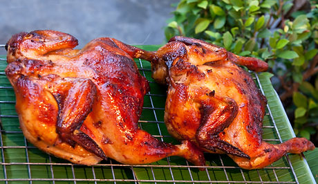 two delicious grilled chicken on palm le
