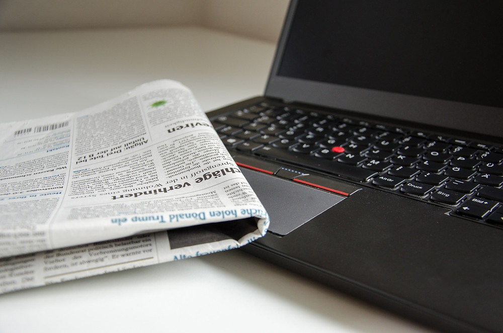 laptop with newspaper