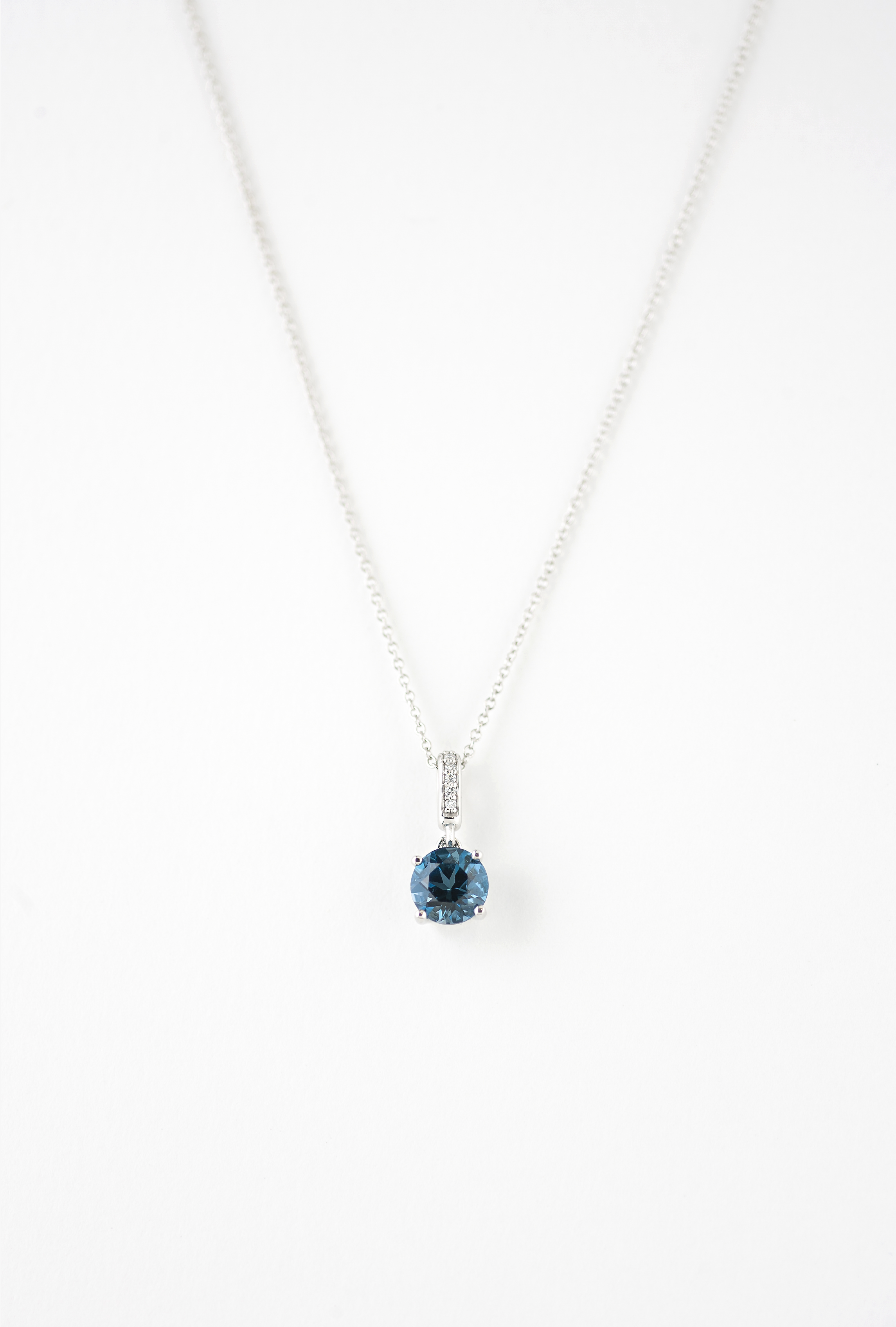Blue topaz and diamond pendent