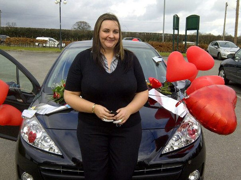 kelly picking up her first Car that she achieved