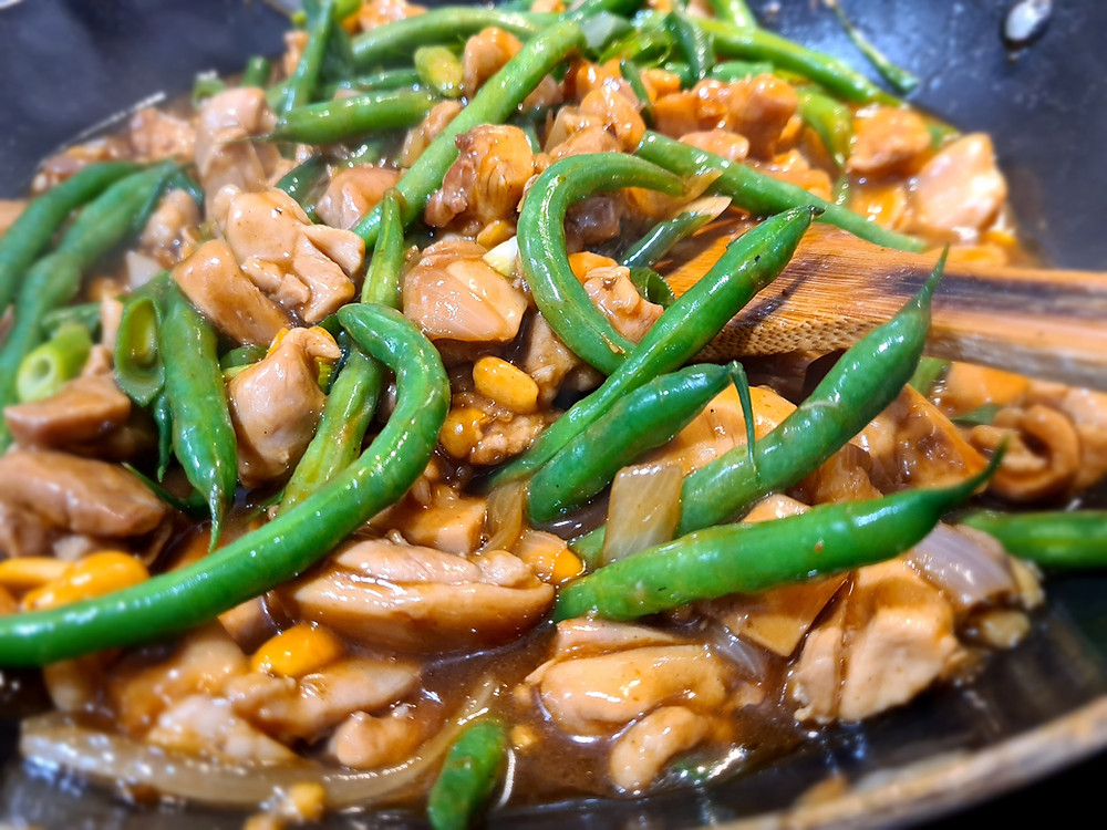 Mouth watering traditional Chinese kung pao chicken with chilies, green beans and roasted peanuts