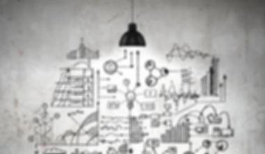 Drawn business plan on wall illuminated