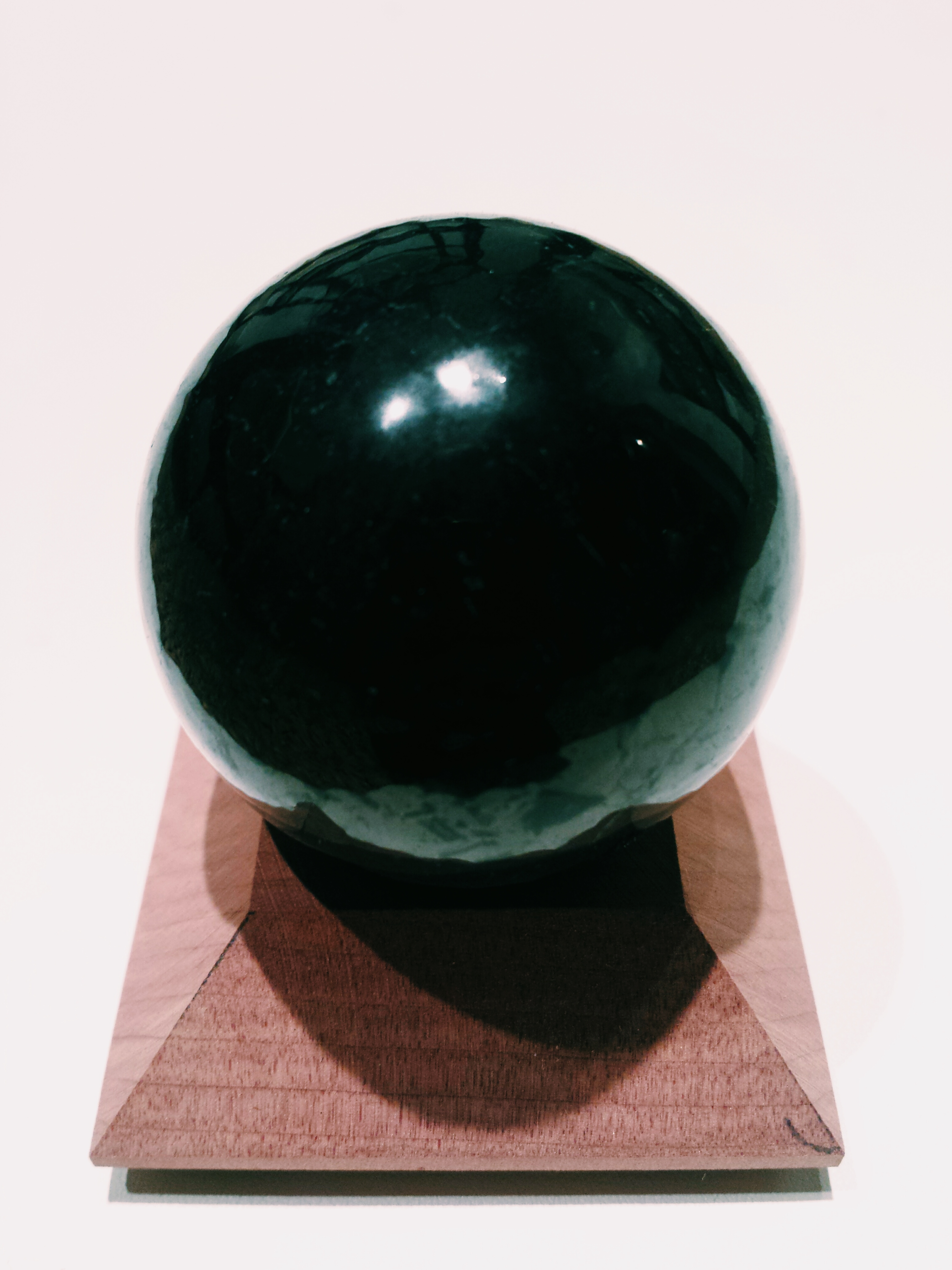 Shungite Sphere on Wooden Stand