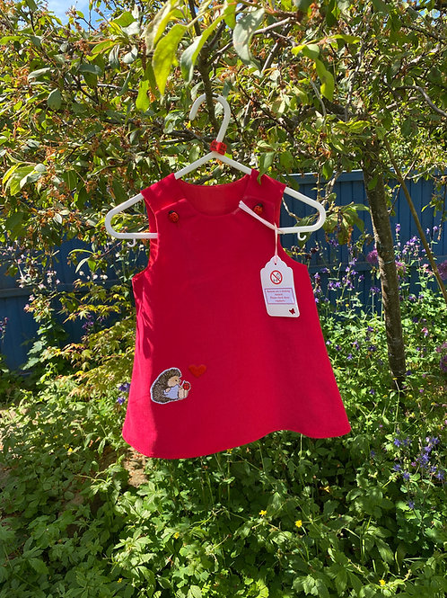 Handmade red baby needlecord dress with hedgehog 0-6 months