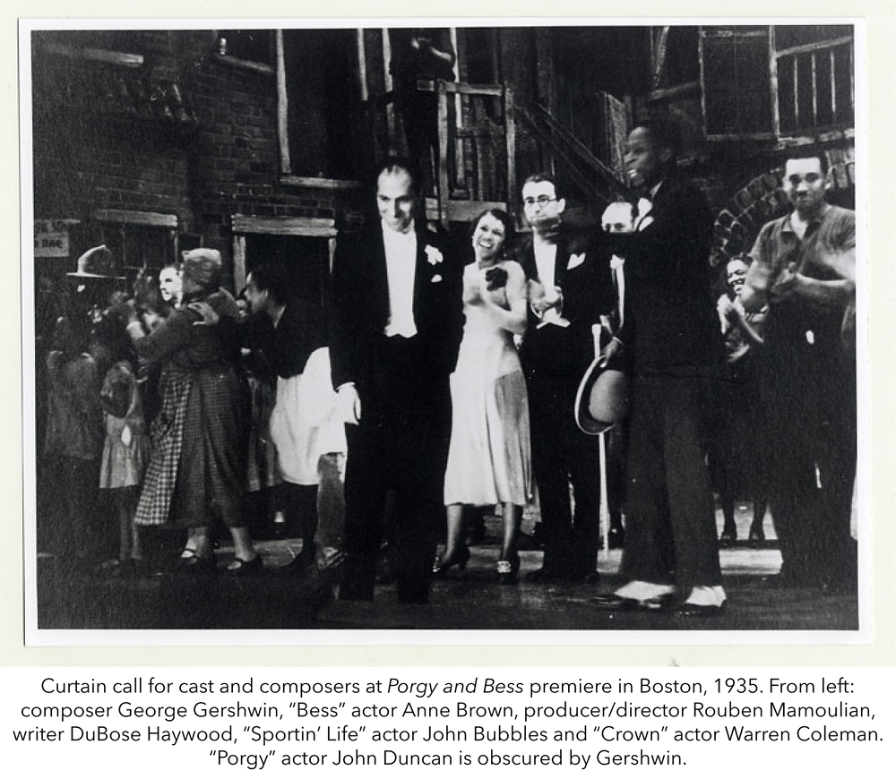"""Curtain call for cast and composers at Porgy and Bess premiere in Boston, 1935. From left: composer George Gershwin, """"Bess"""" actor Anne Brown, producer/director Rouben Mamoulian, writer DuBose Haywood, """"Sportin' Life"""" actor John Bubbles and """"Crown"""" actor Warren Coleman. """"Porgy"""" actor John Duncan is obscured by Gershwin."""