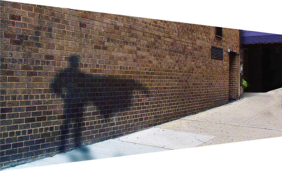 a syfter superhero shadow appears on a brick wall