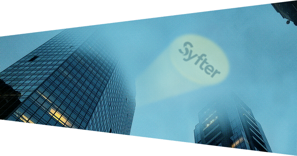 buildings rising into clouds with the syfter symbol shining in the sky