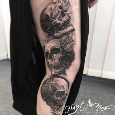 drei-schaedel-tattoo.jpg