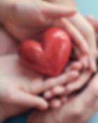 family-holding-a-heart.jpg