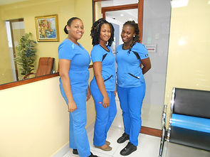 Three dental trainees (2 permanent  1 on training) (right)  at Advanced Dental Care Centre Ltd, Chaguanas