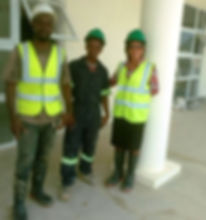 Servol Plumbing trainee (middle) and employer on a jobsite