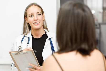 female-doctor-explaining-diagnosis-to-he