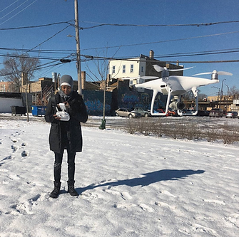 Elodie Edjang operating white drone during snowy Chicago Winter