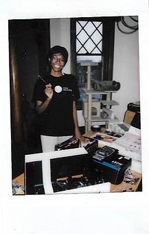 Elodie Edjang posing with custom video editing pc build