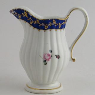 Fluted cream jug.