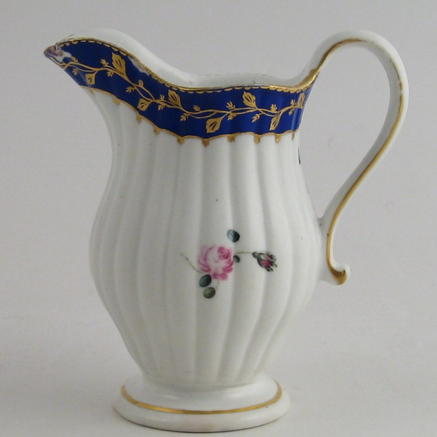 Fluted cream jug.