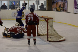 FALCONS SCORE EARLY AND THEN HANG ON FOR WIN OVER REDWINGS