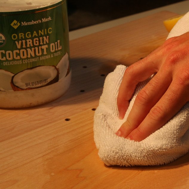 Coconut oil with beeswax to season the board.