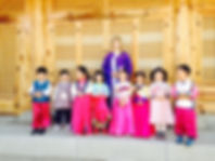 Sarah O pic with students in Hanbok.jpg