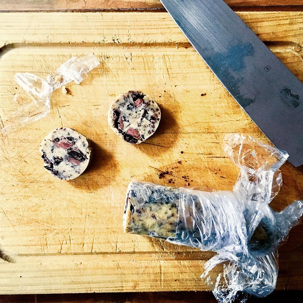 cutting cookie dough rolls