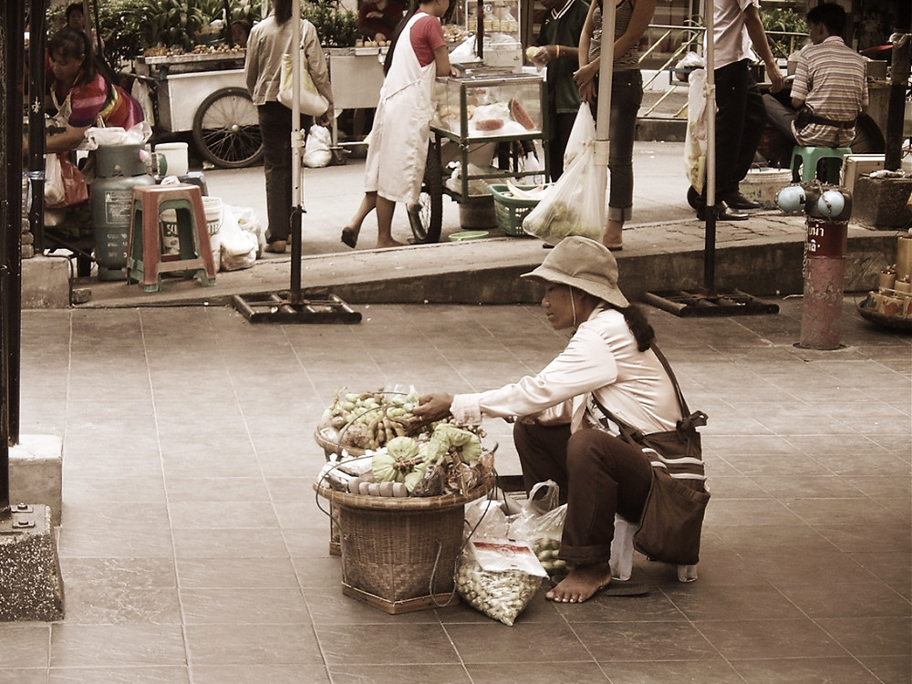 Street Food Bangkok - lady selling tamarind, limes, palm sugar and spices