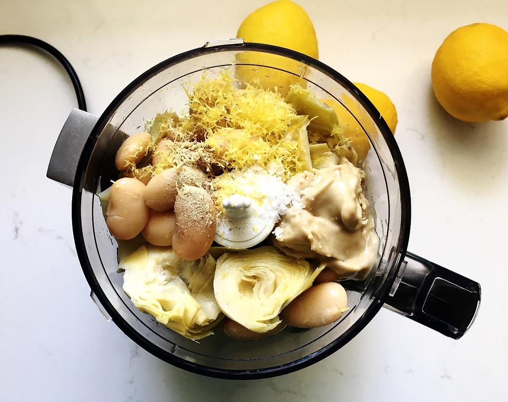 mixing artichoke, beans, tahini and lemon juice/zest