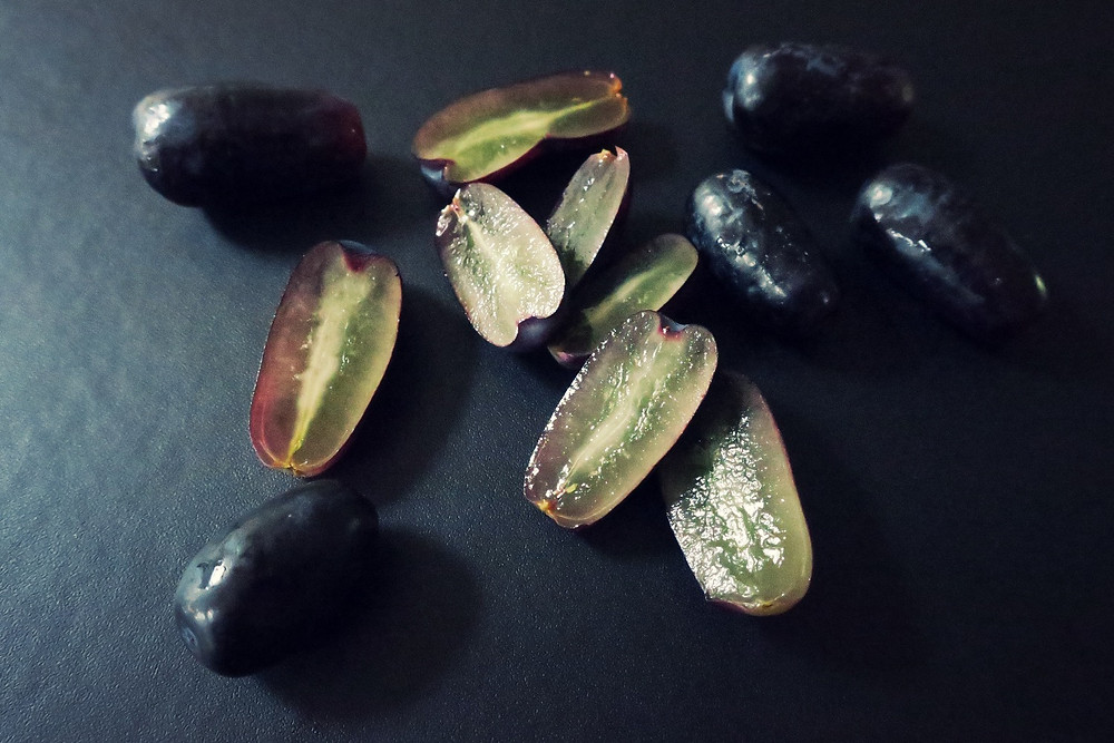 Sweet Sapphire grapes, cut to show their translucent centre