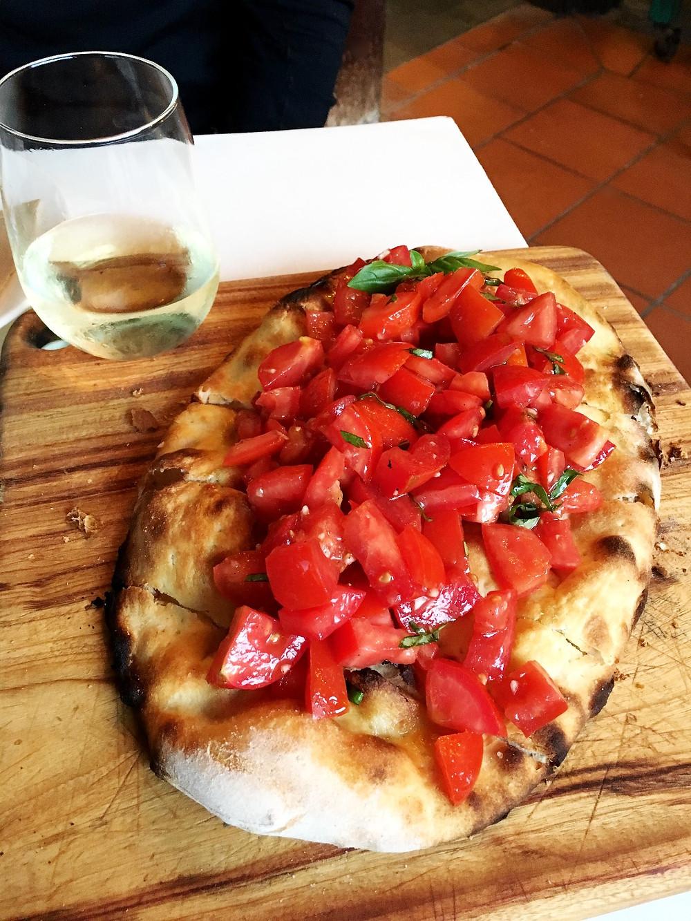 Bruschetta pizza with delicious local tomatoes