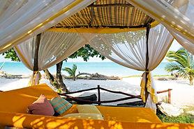 AfroChic - Swahili bed on beach.jpg