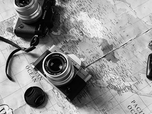 black-and-silver-dslr-camera-on-map-3497