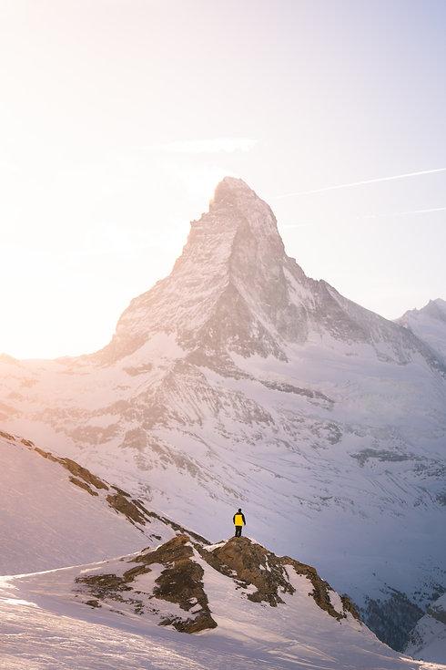man-standing-on-mountain-2406659.jpg