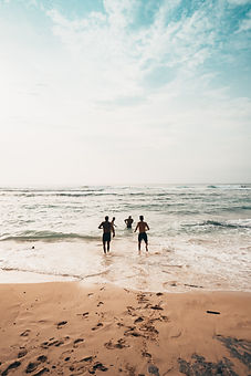 people-running-near-seashore-at-daytime-