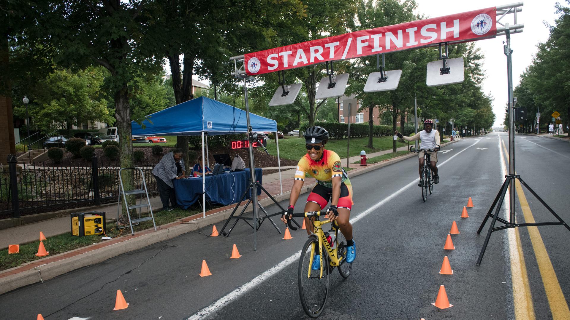 Uphill 5K -- cyclists crossing finish li