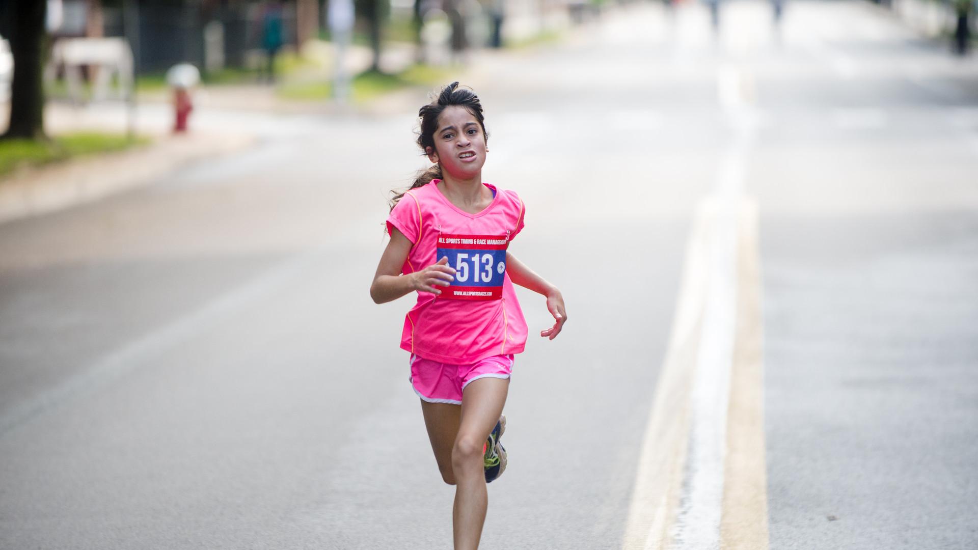 Uphill 5K -- finish line -- female winne