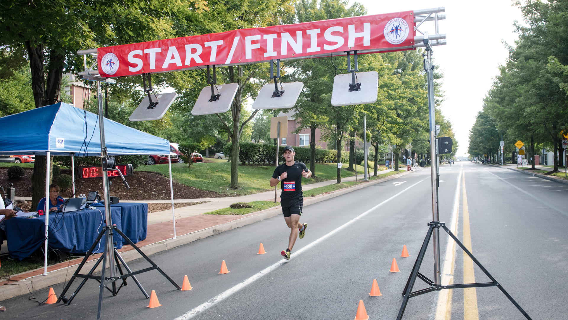 Uphill 5K -- finish line -- male winner.