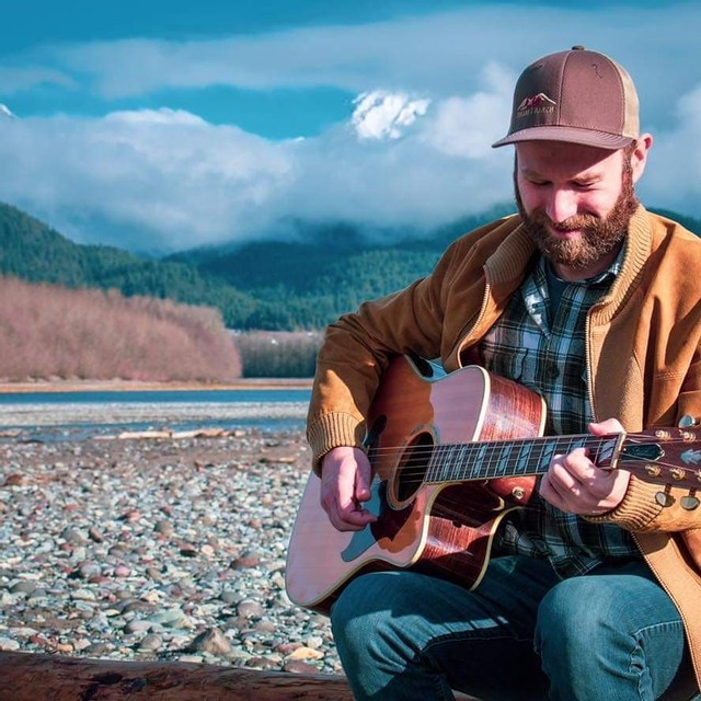 Will Ross Squamish Musician plays guitar in the mountains