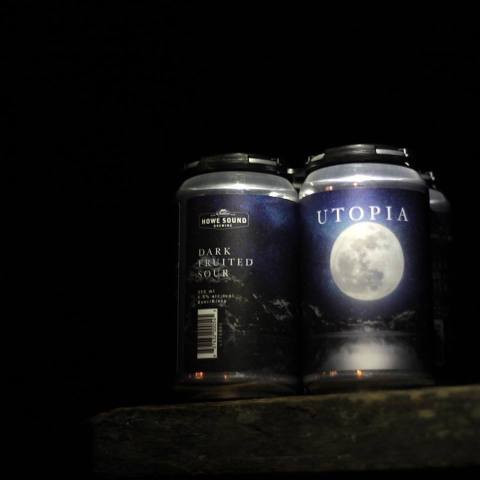 Beer cans with a large full moon in the darkness