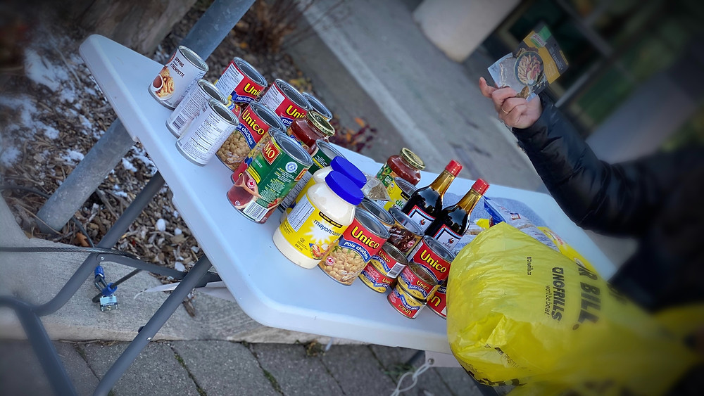 Khavari family donating food at Whitby table of Full Table Project