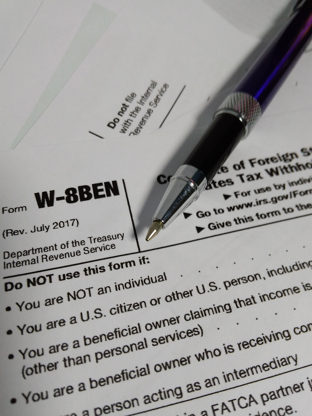 I am a UK taxpayer - how do I complete a W-8BEN