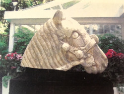 Rare and Significant Giant Stone Head Display
