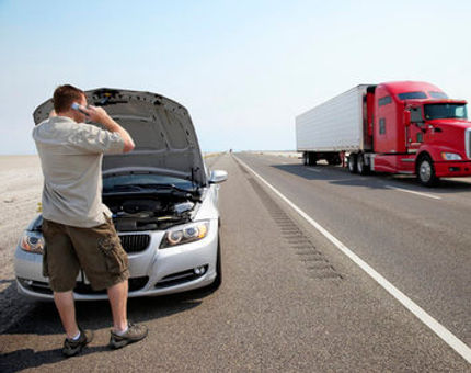 car-breakdown-side-of-highway-man-on-cel