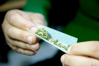 female-hands-rolling-a-marijuana-joint-that-might-kill-you.jpg