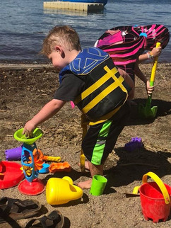 Whalen playing on the beach with all his toys