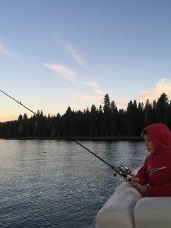 Wyatt Marsh fishing out on our pontoon boat