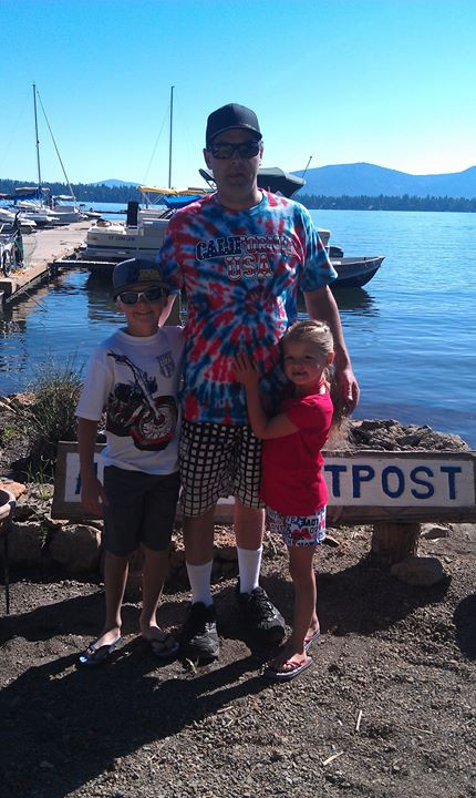 Joe, Mikey and Genna posing together on the 4th of july 2012