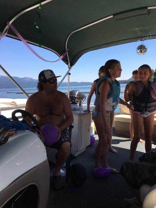 Joe driving al the kids around for a fun lake day.