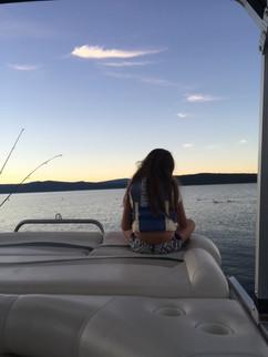 Genna Majors enjoying the veiw off the back of the pontoon boat.