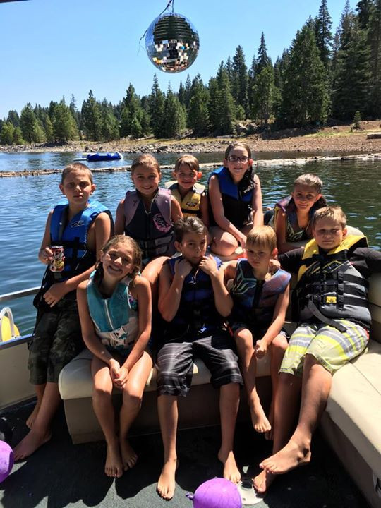 All the kids out on the lake for the perfect day.