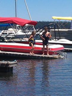 Mikey and Genna swimming with their lifejackets