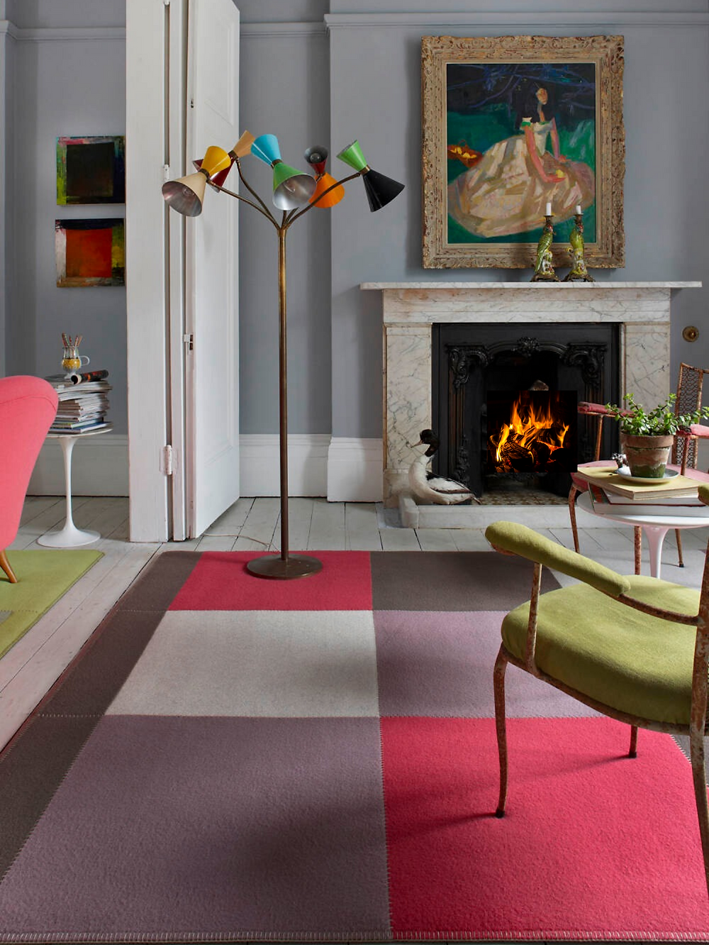 Patchwork style area rug by Roger Oates